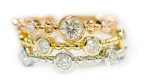 18kt Rose, Yellow, and White Gold Tribute Collection Forevermark Stackable Ring Set
