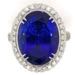 CHRISTOPHER DESIGN 13.85 CARAT TANZANITE AND DIAMOND 18K WHITE GOLD HALO DESIGNER RING