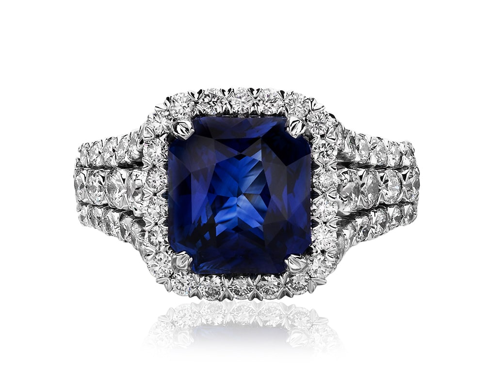 18kt white gold cushion halo sapphire and diamond ring