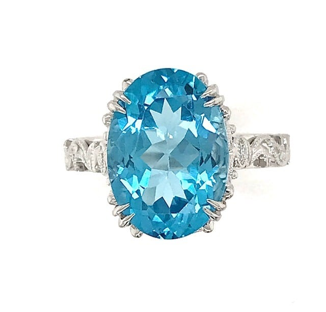 OVAL SHAPED SKY BLUE TOPAZ AND DIAMOND 14K WHITE GOLD RING