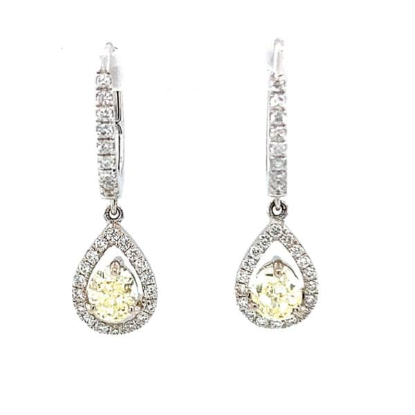 Lady's 18kt white gold pear shape halo dangle fashion diamond earrings. (2) Oval shape yellow diamonds have a total weight of 0.87cts. Remaining (54) diamonds have a total weight of 0.38cts, are round, G-H in color and VS-SI in clarity at 10X. Earrings weigh 2.1 DWT.